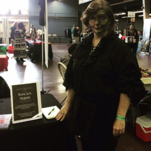 The author in green monster makeup as a character from her books.